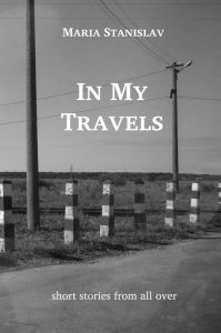 Black and white photograph of a road flanked by bollards and electric posts. In My Travels by Maria Stanislav. Short stories from all over. Link to the book page.