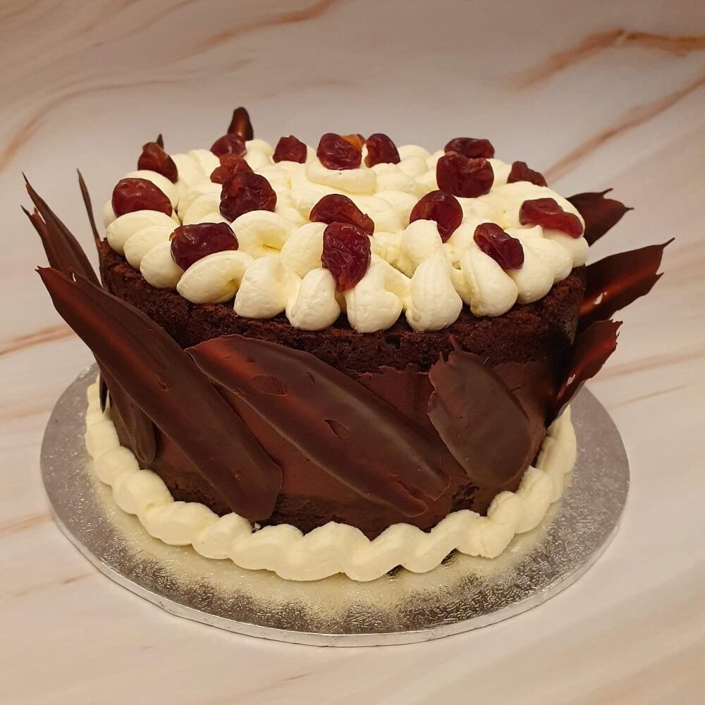 Black forest birthday cake with chocolate shard decorations
