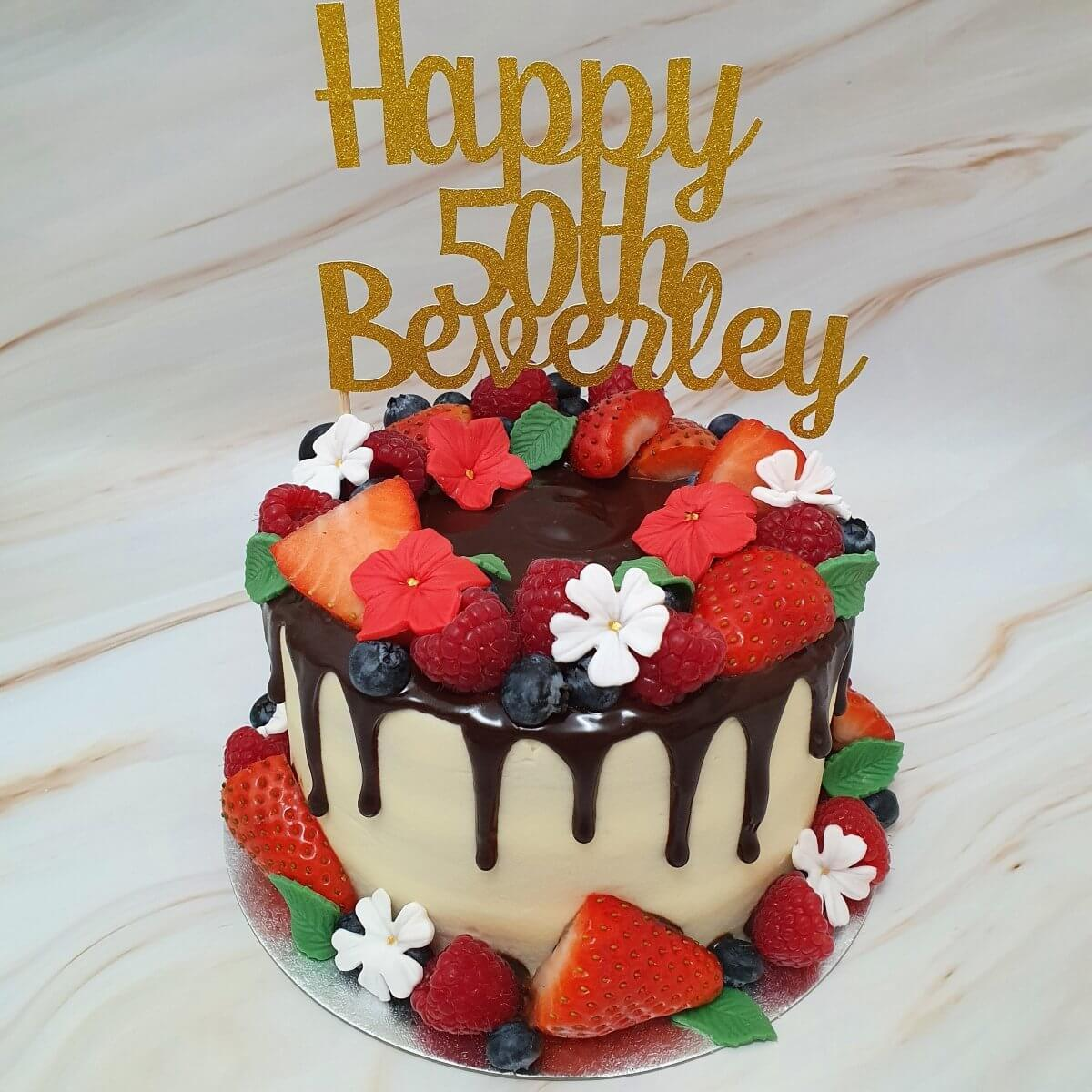 Fruit and flowers birthday cake delivered Milton Keynes