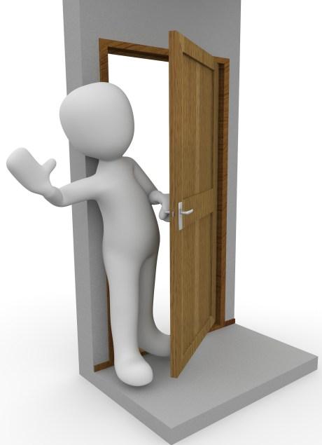 Hand on doorknob at prenatal visit
