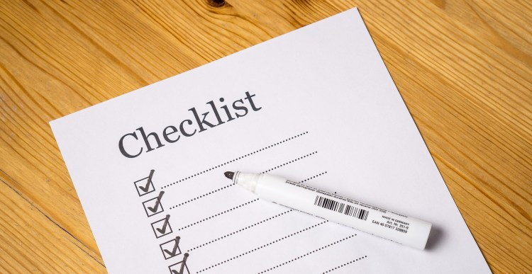 Checklist and pen. Making a checklist for your IBLCE Exam application helps plan ahead.