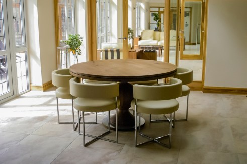 Yask Iron Lady table and the Porada anxie cream leather chairs at Marie Charnley Interiors