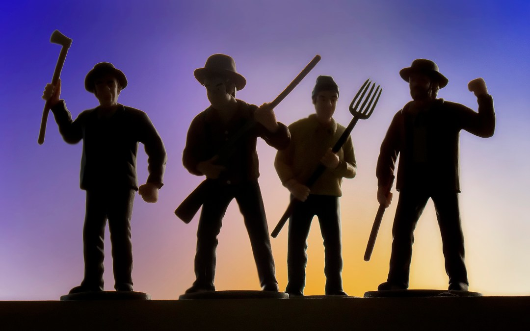 image of angry mob of four against a setting sun
