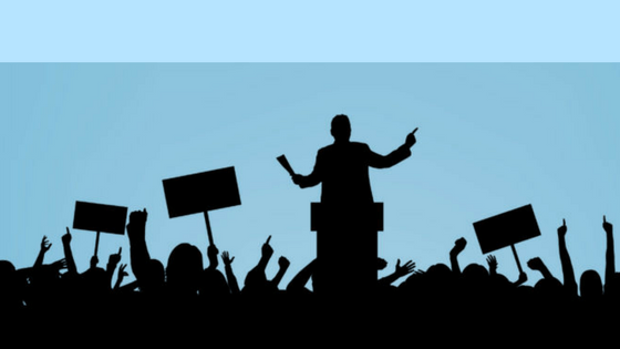 LInkedIn, Politics and your brand silhouette image of political rally. Used for post on mariedeveaux.com about online personal branding