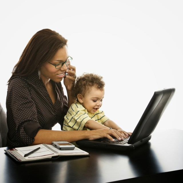 Image of working Black mom and her child learning how to leverage LinkedIn as a toll to grow her business thanks to Marie Deveaux career coach for Black Women in business