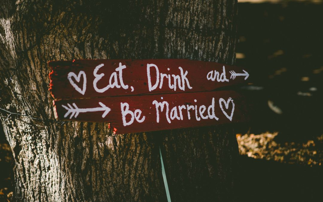Eat drink and be married sign as marie deveaux, career and business coach outlines how to have an annual review of your marriage