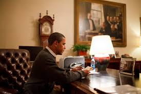 President Obama sits in his office in the White on a late night, reading as he was known to do late into the evenings, a clear demonstration of his notorious 5 hours a night of sleep.