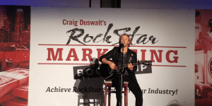 Craig Wayne Boyd sings to an audeince of eager entrepreneurs at Craig Duswalt's Rockstar Marketing Bootcamp in Los Angeles October 2018