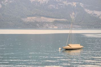 A lonely boat in the middle of a lake