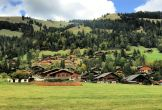 More pleasant chalets sitting on green hills