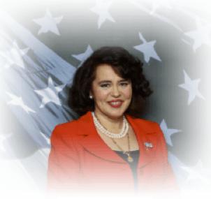 Copyright © 2013 Marielena Montesino de Stuart. All rights reserved. MARIELENA MONTESINO DE STUART WITH AMERICAN FLAG.