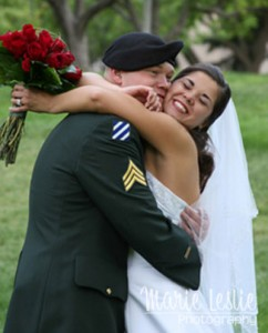 joyous bride and groom in army uniform