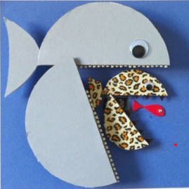 A pale blue paper fish eating a spotted paper fish eating a red paper fish