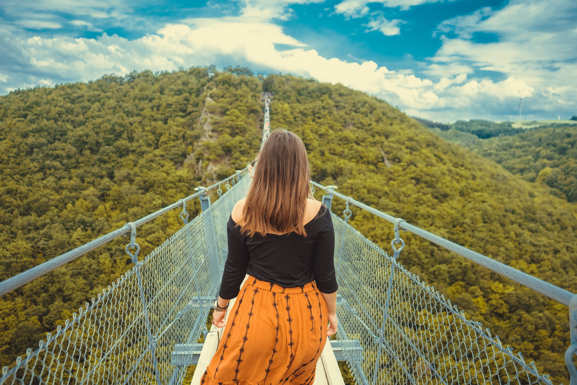 girl on a forest bridge