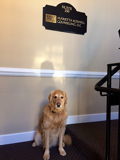 Max in front of the office sign