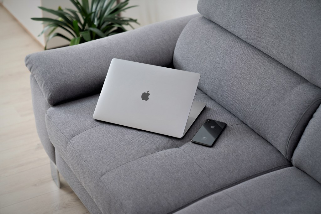 couch with computer and phone