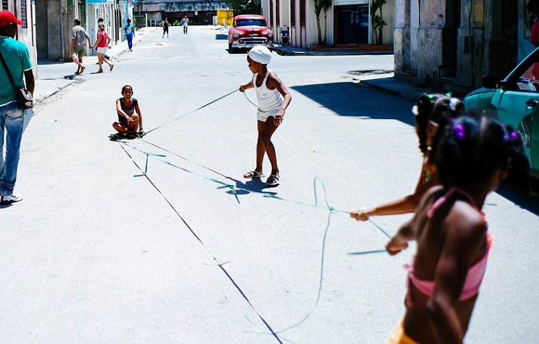 Girls pulling each other on Havana street