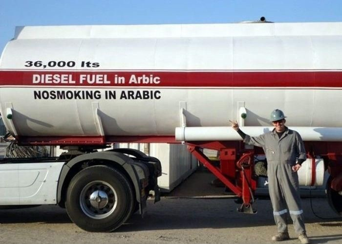 de instructies werden heel letterlijk opgevolgd, Diesel fuel in Arabic and No smoking in Arabic