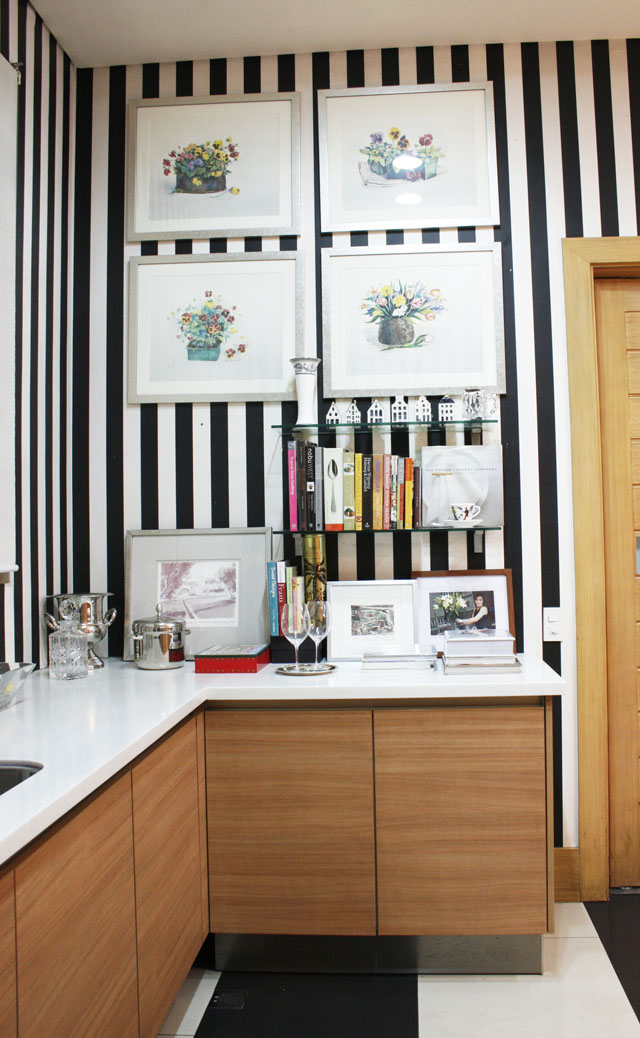 A nook in The Spoiled Mummy's kitchen displays her favorite cook books along with memorabilia from her travels.