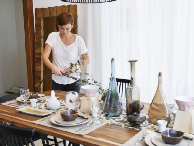 Adding the finishing touches to my tablescape.  I like adding things from nature like branches, twigs or leaves to make the setting feel warm and homey.