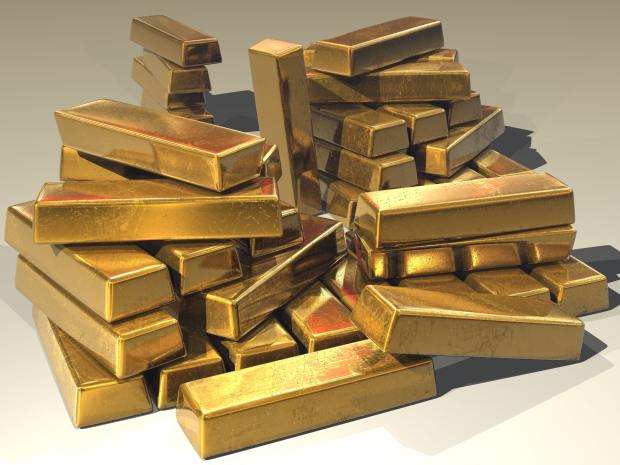 Photograph of a pile of gold bars.