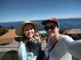 My cousin, Lena, and I hiking up to Amantani island