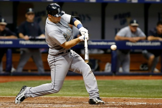 ST. PETERSBURG, FL - MAY 25: Mike Zunino #3 of the Seattle Mariners hits a solo home run during the ninth inning of a game against the Tampa Bay Rays on May 25, 2015 at Tropicana Field in St. Petersburg, Florida. (Photo by Brian Blanco/Getty Images) *** Local Caption *** Mike Zunino