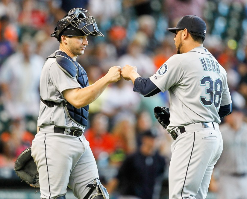 HOUSTON, TX - JUNE 13: Vidal Nuno #38 of the Seattle Mariners bumps fist with Mike Zunino #3 after the final out against the Houston Astros at Minute Maid Park on June 13, 2015 in Houston, Texas. (Photo by Bob Levey/Getty Images)
