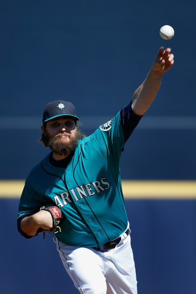PEORIA, AZ - MARCH 10: Starting pitcher Wade Miley #20 of the Seattle Mariners throws a warm up pitch during the frist inning of the spring training game against the Chicago Cubs at Peoria Stadium on March 10, 2016 in Peoria, Arizona. (Photo by Christian Petersen/Getty Images)