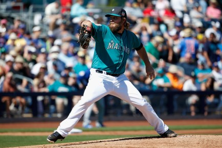 PEORIA, AZ - MARCH 10: Starting pitcher Wade Miley #20 of the Seattle Mariners pitches against the Chicago Cubs during the first innnig of the spring training game at Peoria Stadium on March 10, 2016 in Peoria, Arizona. (Photo by Christian Petersen/Getty Images)