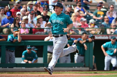 SCOTTSDALE, AZ - MARCH 11: Kyle Seager #15 of the Seattle Mariners scores on an RBI double hit by teammate Franklin Gutierrez (not pictured) in the third inning of the spring trainning game against the San Francisco Giants at Scottsdale Stadium on March 11, 2016 in Scottsdale, Arizona. (Photo by Jennifer Stewart/Getty Images)