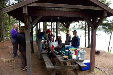 Natalie and Chris hang out while students prepare dinner at Cobscook State Park