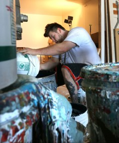 PHOTO BY MARIO BARTEL Mixing FAT Paint is heavy, sometimes messy, work.