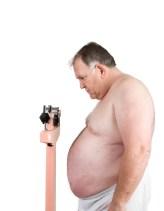 big weighing himself on white