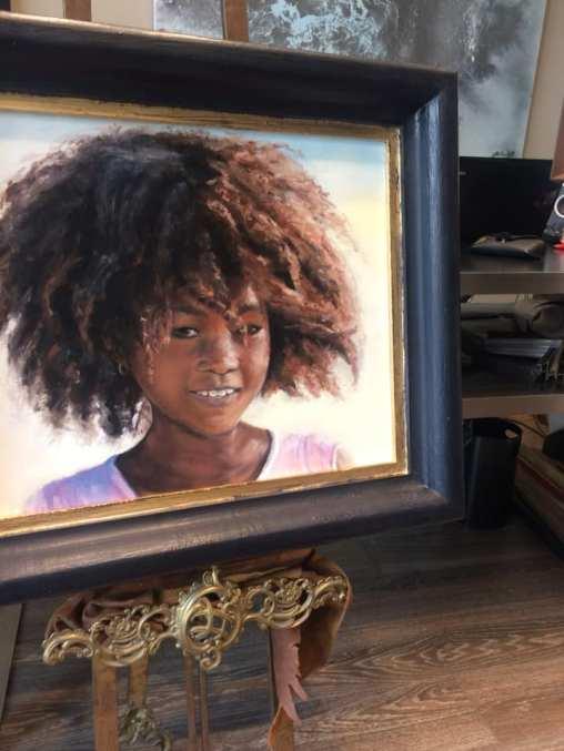 Un precioso retrato en óleo enmarcado