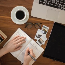 person writing in notebook, ways to jump start your career