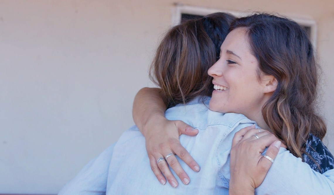 happy people hugging, empowerment confidence coaching