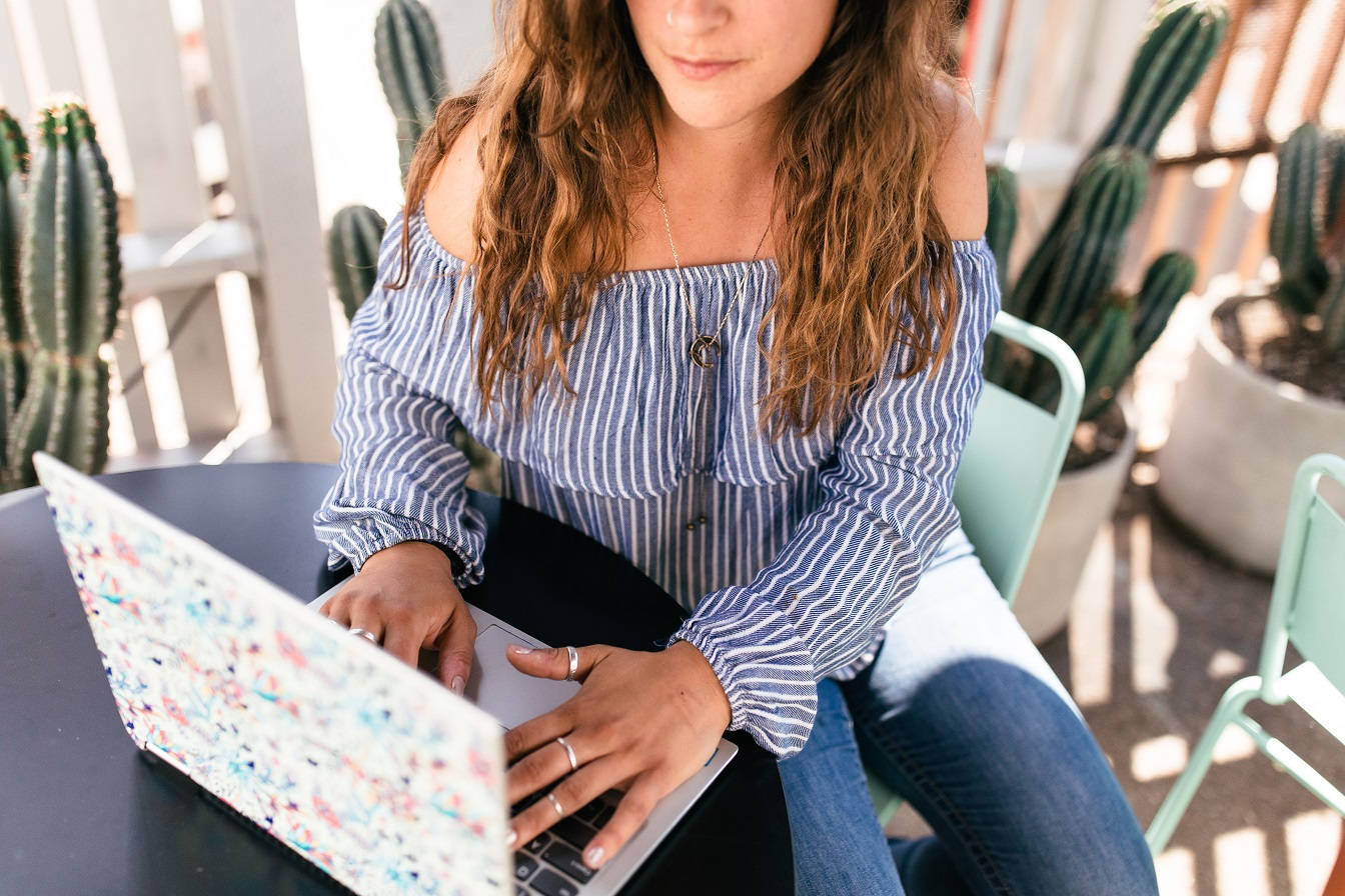 woman typing self-motivation strategies on computer