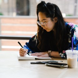 woman writing and increasing personal growth