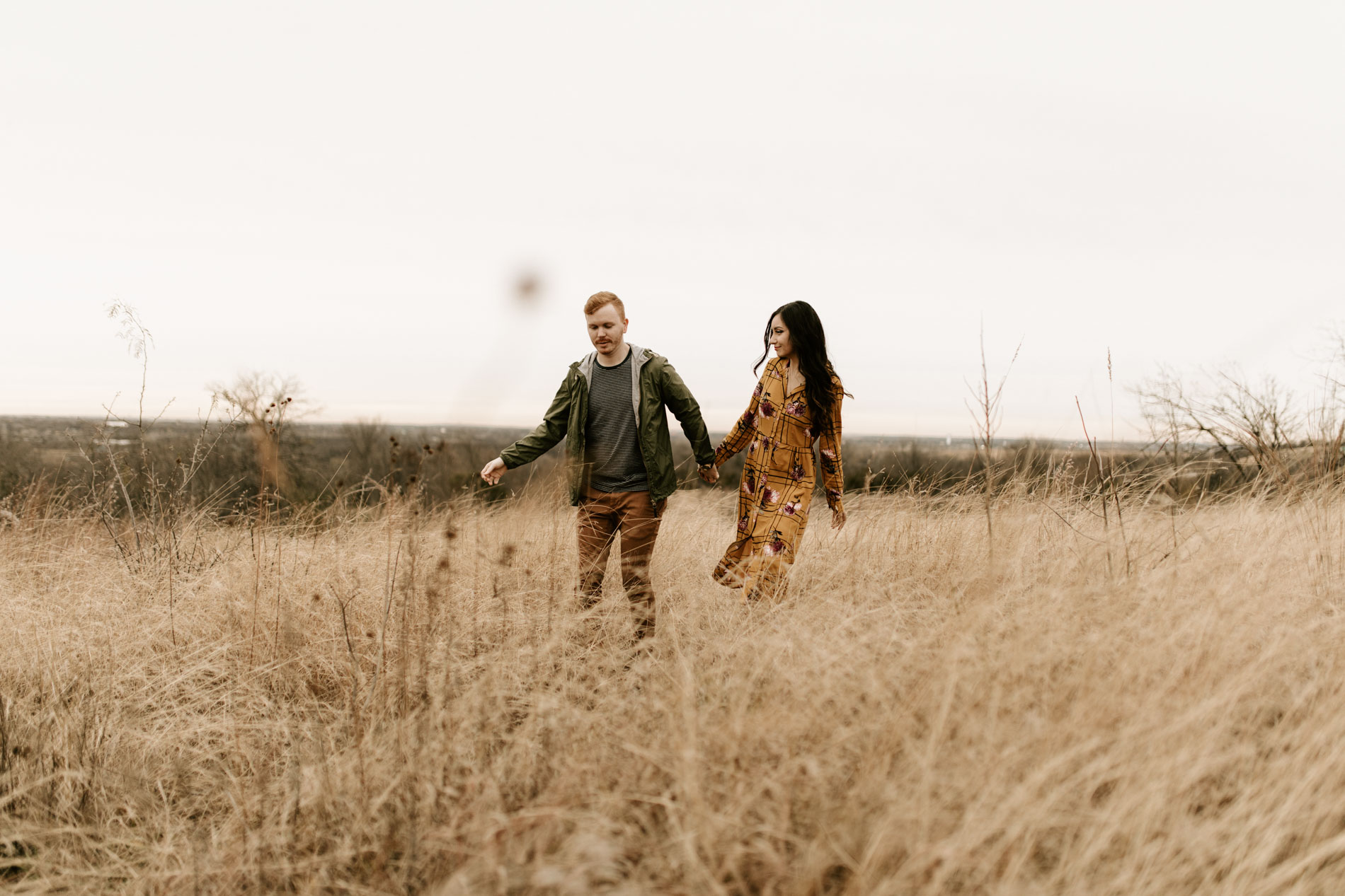couple running in a field in Fort Worth