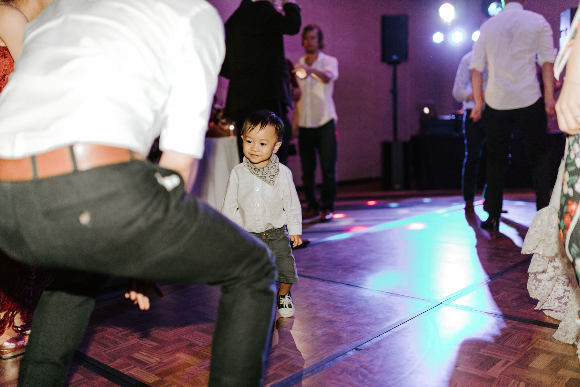 cute kid dancing at wedding reception