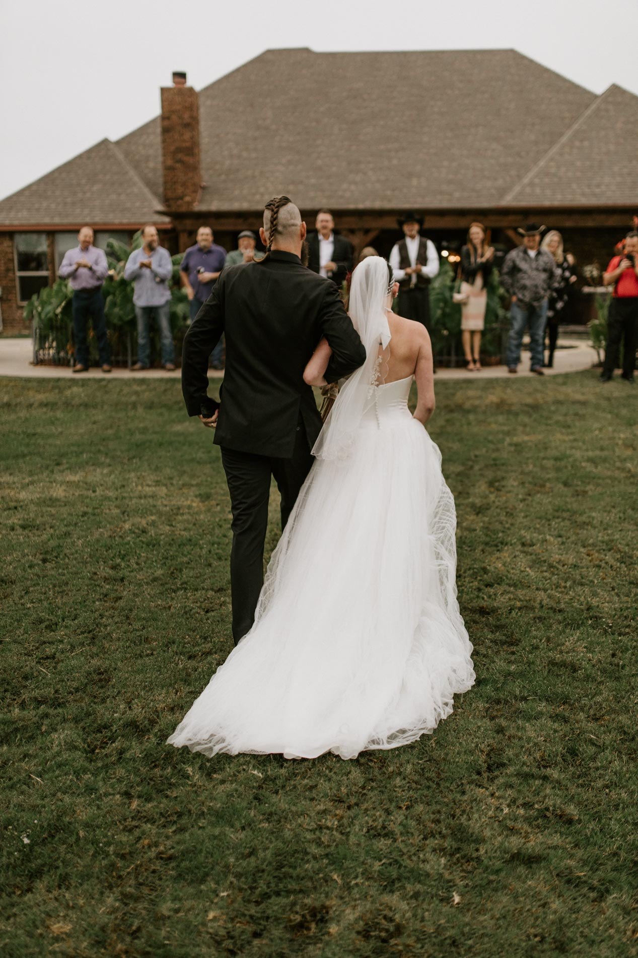bride and groom walking out of wedding ceremony