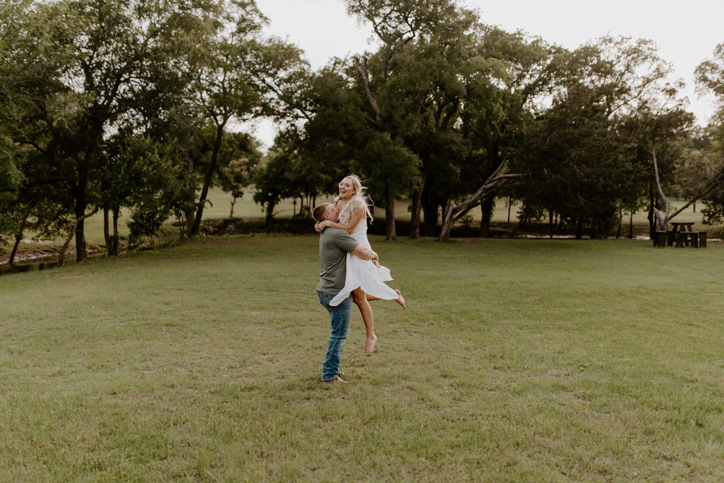 Boy spinning girl around in Fort Worth