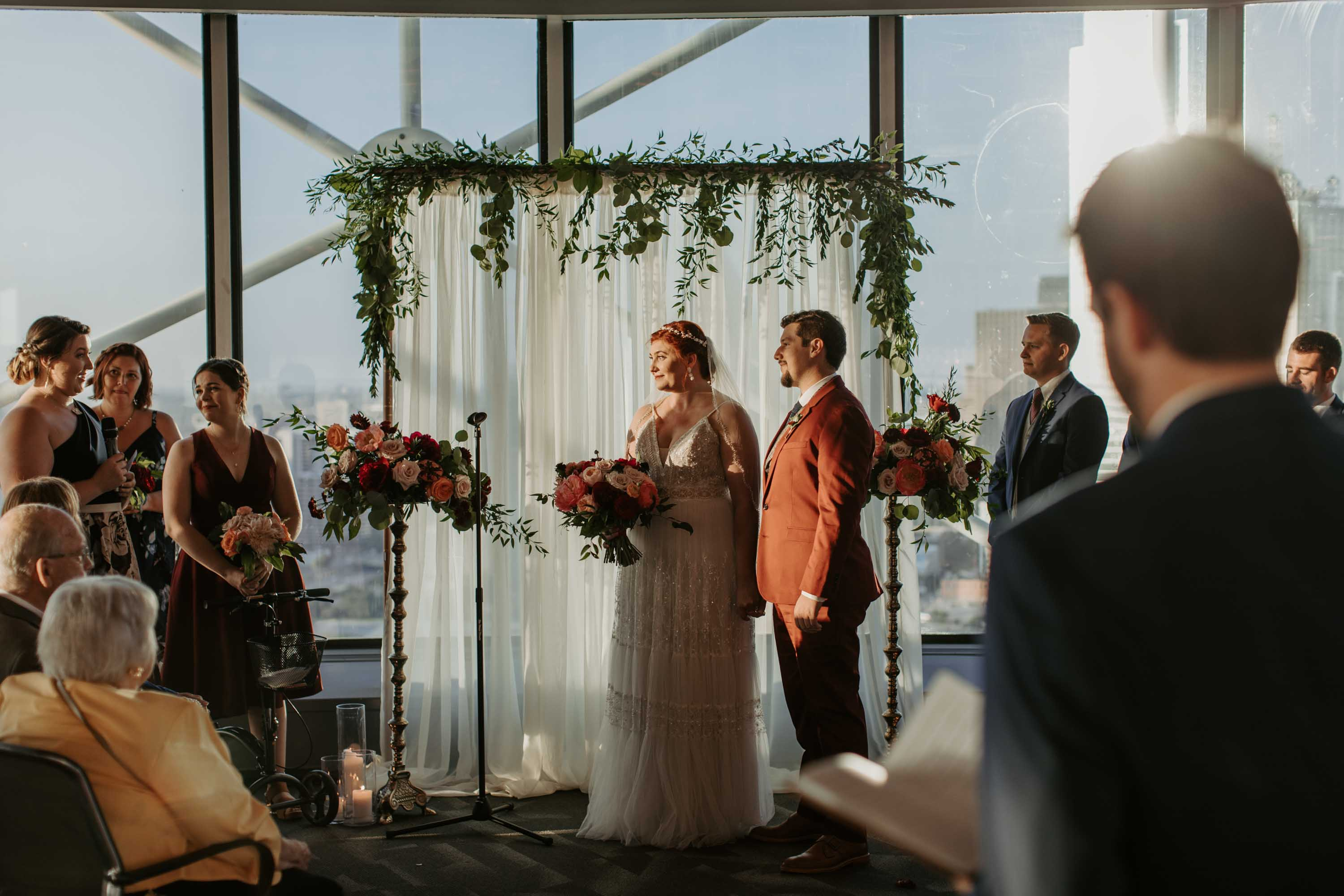 Bride and groom listening to wedding speeches in Dallas texas
