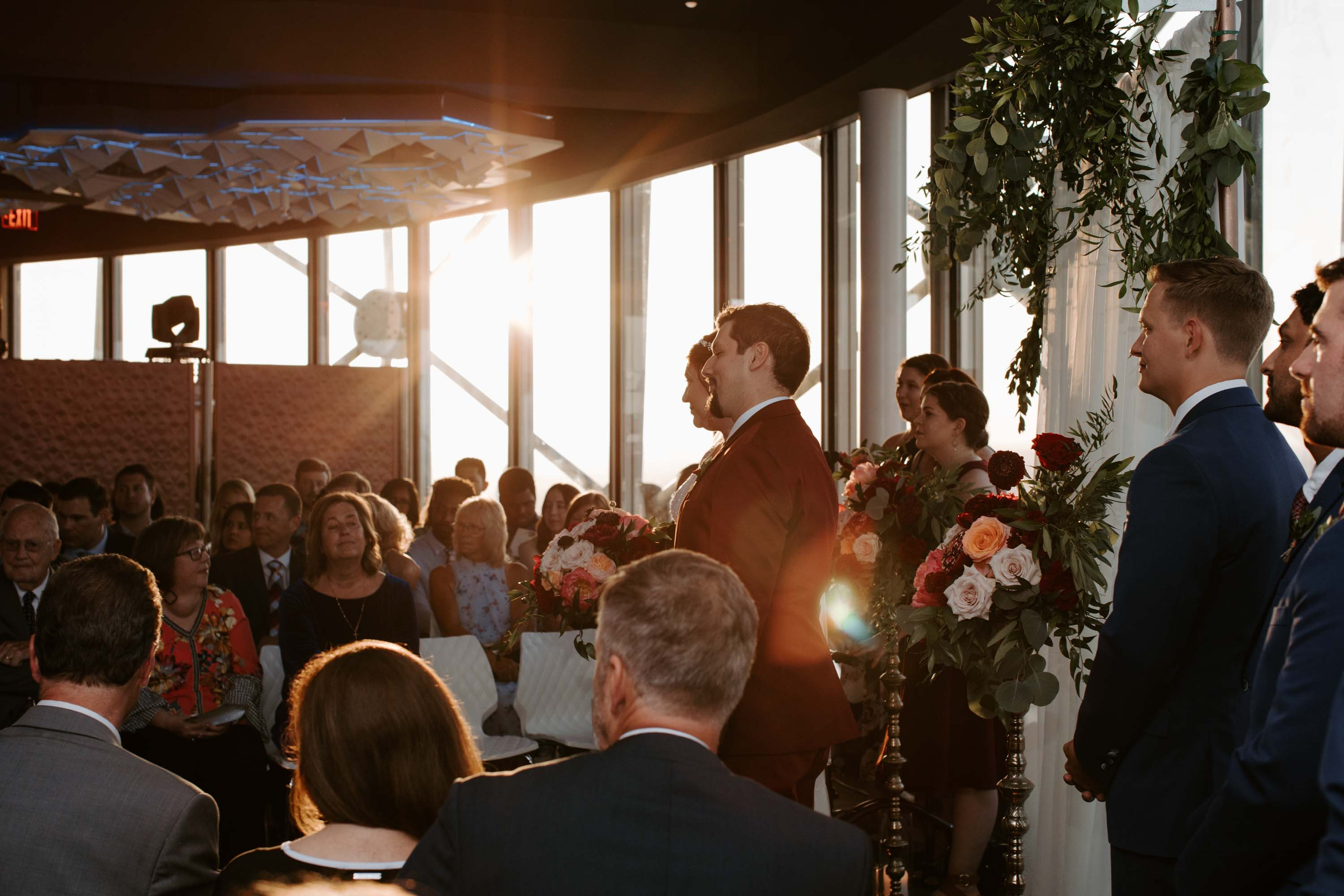 Wedding ceremony backlit beautiful lighting in reunion tower Dallas TX