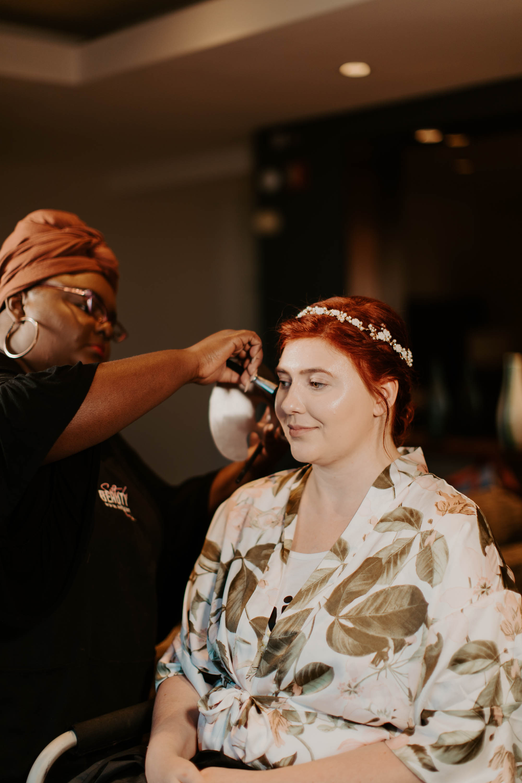Redhead bride getting ready in hotel before wedding ceremony
