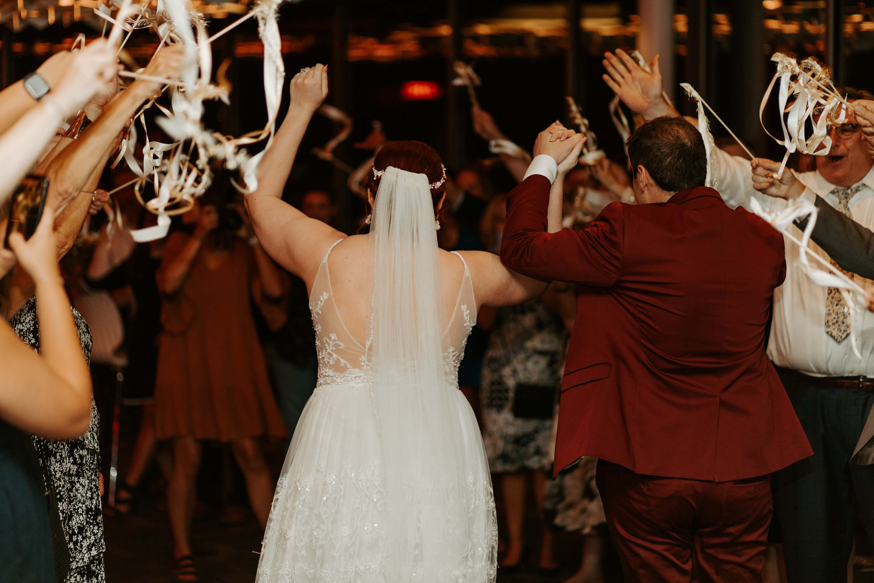 Bride and groom making their grand exit from reunion tower in Dallas texas