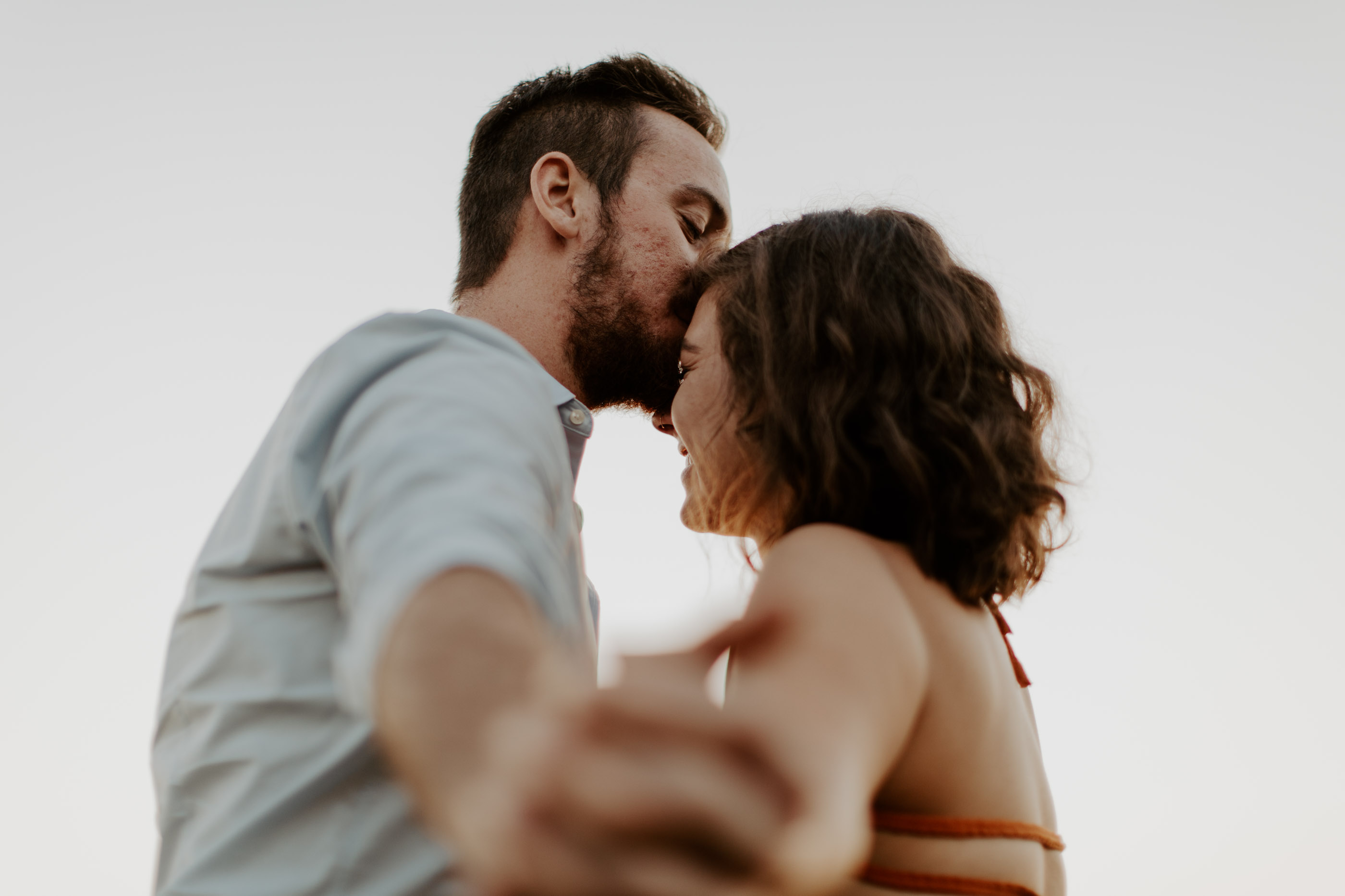 boy kissing girls forehead engagement photo prompt