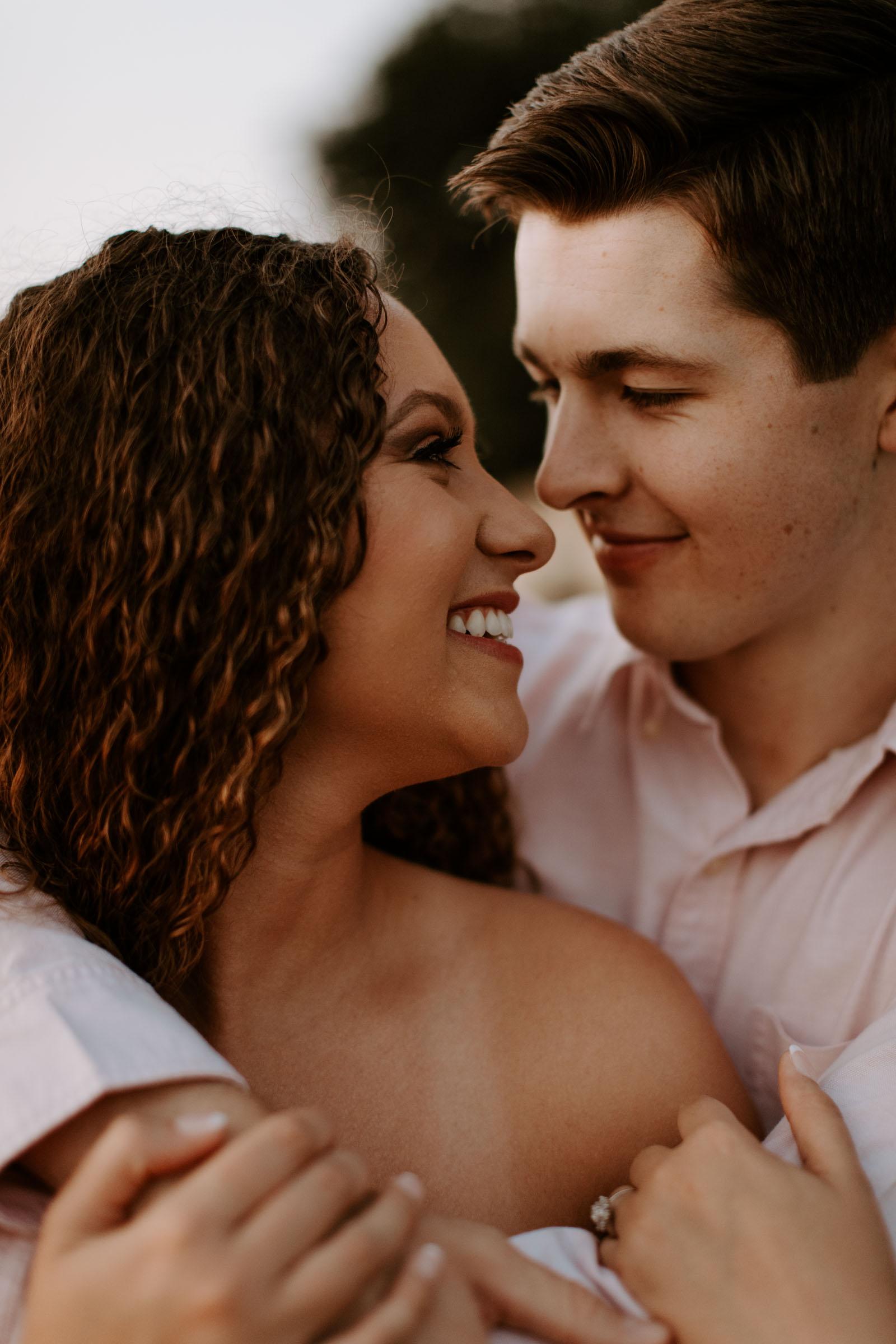 Adorable couple at sundown at lakeside in Dallas texas