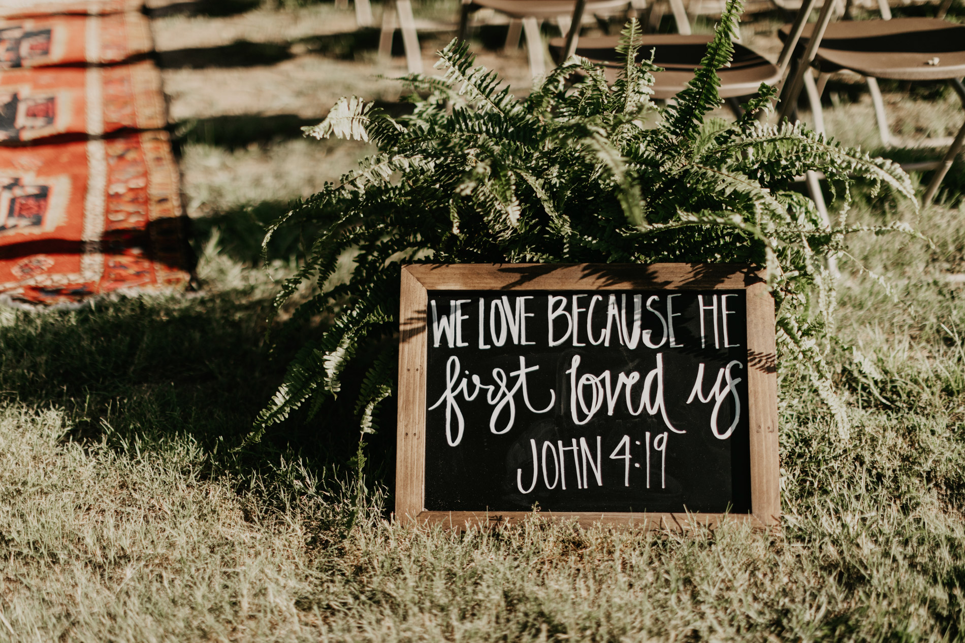 Bible verse sign at bohemian wedding